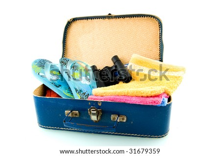 Suitcase with sandals, field-glasses and towels on white background