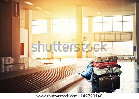 Suitcases on a cart at the airport arrival terminal