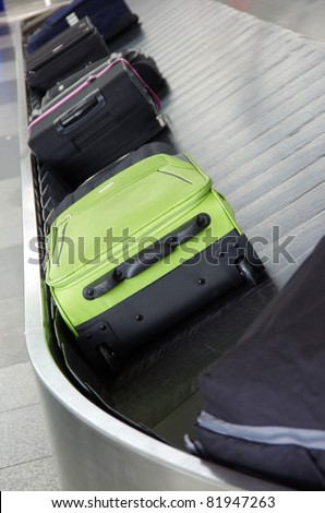 suitcases on the baggage conveyor band on the airport
