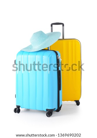 Suitcases on white background #1369690202