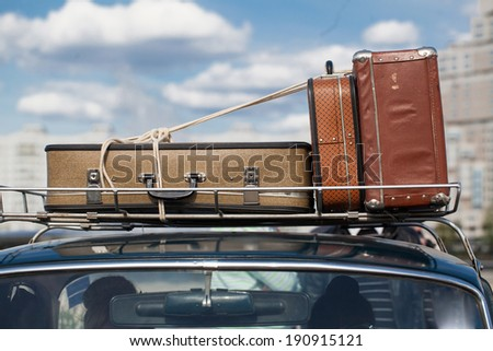 suitcases tied with rope on a...