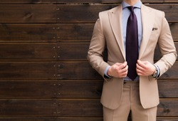 Suited man posing
