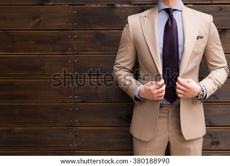 Suited man posing