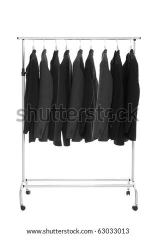 Suits on a Dress Rack isolated on white background