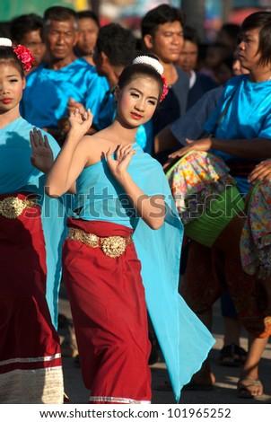 SUKHOTHAI,THAILAND- NOVEMBER 10 :Unidentified dancers perform at the Thai Dance in Loy Krathong festival on November 10,2011 Sukhothai,Thailand . - stock photo