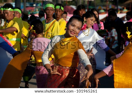 SUKHOTHAI,THAILAND-NOVEMBER 10 :Unidentified dancers perform at the Thai Dance in Loy Krathong festival on November 10,2011 Sukhothai,Thailand .