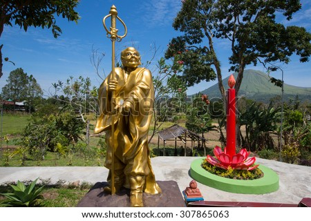 SULAWESI, INDONESIA - AUGUST 8.2015:,a man with a stick,complex Ban Hin Kiong Temple, north Sulawesi,August 8. 2015  Sulawesi, Indonesia. #307865063