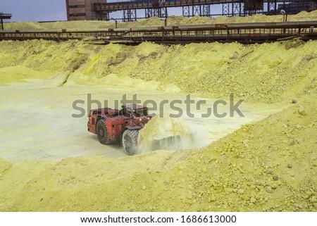 sulfur factory. tractor loading sulfur Stok fotoğraf ©