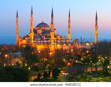 Sultan Ahmet Blue Mosque in Dusk.  This is just after the sunset.  Mosque is lighted by the lights to appear in golden light. - stock photo