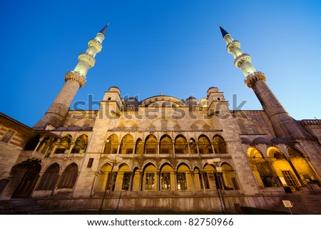 Sultan Ahmet Mosque architecture also known as the Blue Mosque (left side, the one facing Hagia Sophia) at night in Istanbul, Turkey, Sultanahmet district