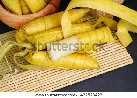 Suman sa Ibos, a traditional sticky rice cake wrapped in buli leaves Stock fotó ©