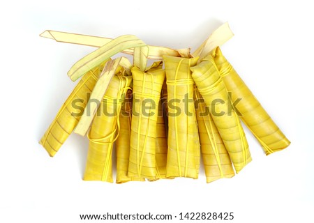 Suman sa Ibos, a traditional sticky rice cake wrapped in buli leaves on white background Stock fotó ©