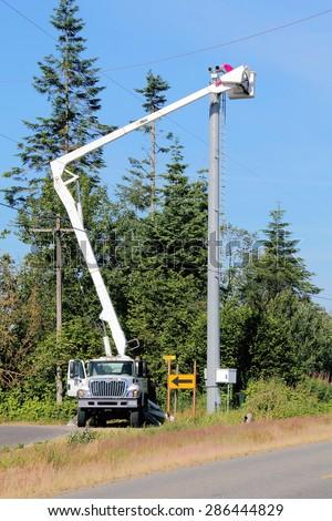 SUMAS, WASHINGTON/UNITED STATES â?? JUNE 11, 2015: Technicians upgrade state of the art border surveillance equipment in Washington State on June 11, 2015.