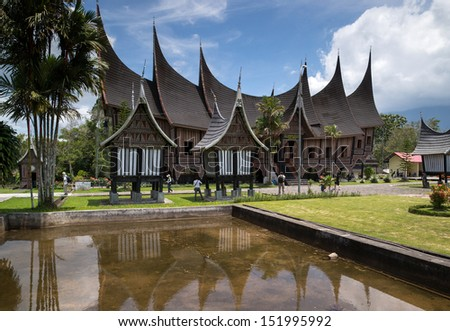 SUMATERA - AUGUST 23: Tourists and photographers visit the Gadang House in Padang Panjang, West Sumatra, Indonesia on August 23, 2013.  The 'Minangkabau' architecture features horns on rooftops.