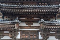 Sumigawara, Dragon roof ornament (Tomebuta), Tomoemon (comma pattern) Tomoegawara end tiles and tokyou bracket complex at Kondo (Main Hall) of To-ji Temple, Kyoto, Japan