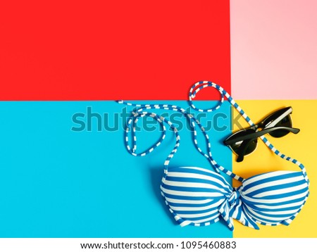 summer accessories and minimal flat lay concept from bikini, cloth and vacation item decorate on pastel and colorful background #1095460883