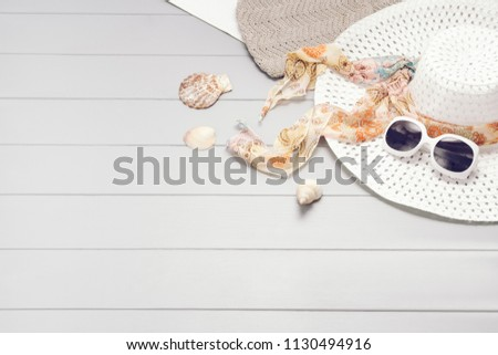Summer accessories, vacation, travel, holiday top view background. Female accessories assortment. Womans hat and frame composition. Summertime and tourism concept #1130494916