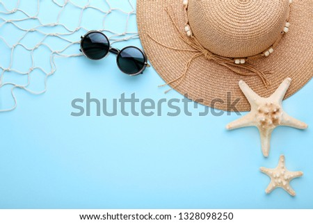 Summer accessories with starfishes on blue background