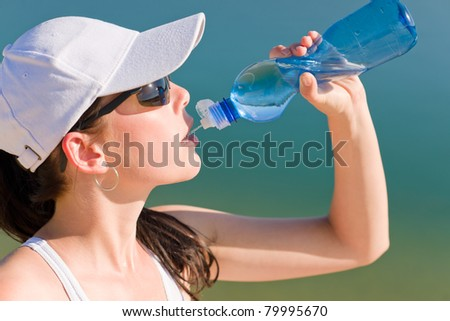 Summer active woman drink water bottle in fitness outfit
