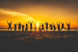 Summer activity lifestyle silhouette group of friends or traveler joy fun jumping on beach at sunset, Leisure tourist people travel Thailand holiday vacation trips, Tourism beautiful destination Asia