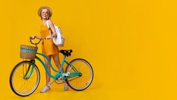 Summer Adventures. Portrait Of Cute Teen Hipster Girl With Vintage Bike Over Yellow Studio Background, Panorama With Copy Space
