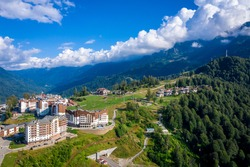 Summer aerial view of the Ski Resort Rosa Khutor. A complex of hotels on the site of the former Olympic village of Rosa Plateau at an altitude of 1170 m from sea level. Krasnaya Polyana, Sochi, Russia