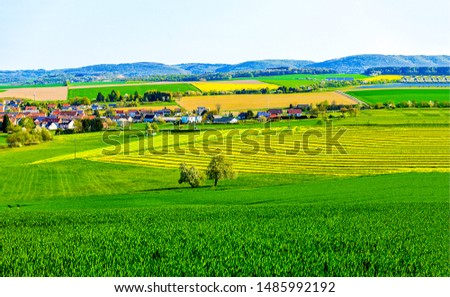 Summer agriculture field town landscape. Agriculture farmland landscape. Farmland agriculture fields view. Agriculture valley field view
