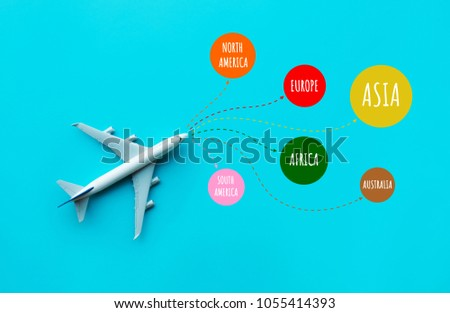 Summer and around the world concept with model plane,airplane on blue pastel color background. #1055414393