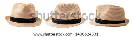 Summer and beach fashion, personal accessories and holiday head wear concept theme with multiple straw hats or fedoras with a black strap or ribbon isolated on white background with a clip path cutout Stock photo ©
