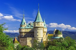 Summer at famous Bojnice castle and Prievidza city in Slovakia. Bojnice castle is the best known Slovak castle and it is very popular for tourists because of romantic nature of this place,Slovakia