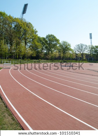 summer athletic stadium with run race tracks and light masts