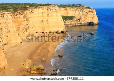 Summer Atlantic rocky coast view with sandy beach Praia da Afurada (Lagoa, Algarve, Portugal).