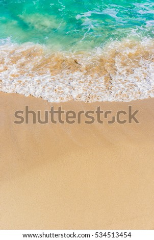 Summer background, holiday season, soft wave of turquoise blue sea water on sand beach, with copy space. #534513454