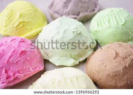 Summer background. Set of various flavored ice cream scoops on stone table, copy space. Refreshment, traditional seasonal cold sweets