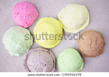 Summer background. Set of various flavored ice cream scoops on stone table. Refreshment, traditional seasonal cold sweets