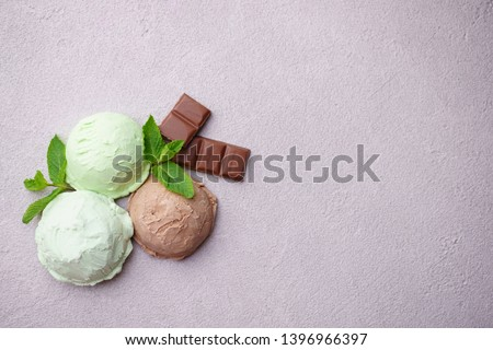 Summer background. Set of various ice cream scoops. Chocolate and mint flavored dessert on stone table, copy space. Refreshment, traditional seasonal cold sweets