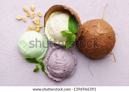 Summer background. Set of various ice cream scoops. Coconut, mint and berry yoghurt flavored dessert on stone table, copy space. Refreshment, traditional seasonal cold sweets