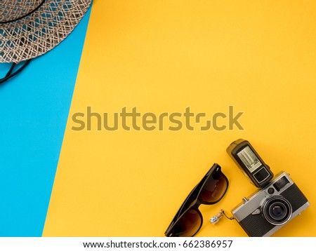 Summer Background, Summer holiday concept, Travel Concept with camera, glasses and hat on blue and yellow background. - Shutterstock ID 662386957