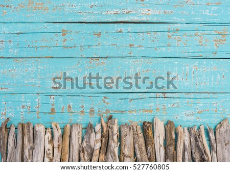 Summer background, turquoise blue wood with driftwood decoration and copy space. Holiday season.