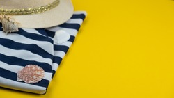 Summer background with beach tunic, hat and seashells. Copy space