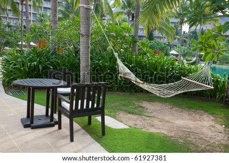 Summer backyard with outdoor furnitures and hammock
