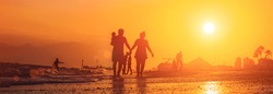 Summer banner with people in front of tropical baackground during sunset. Happy family with baby and tourist silhouettes on the beach during sunset in summer.