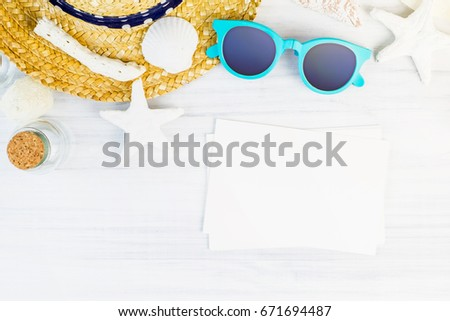 Summer Beach accessories (White sunglasses,starfish,straw hat,shell) and photo frame on white plaster wood table top view,Summer vacation concept,Leave space for adding your photo.