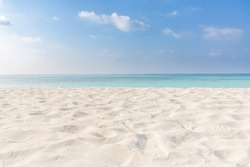 Summer beach background. Sand and sea and sky