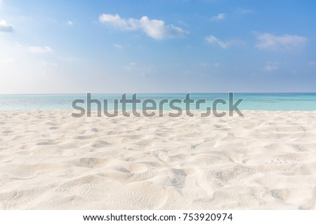 Summer beach background. Sand and sea and sky  #753920974