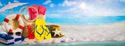 Summer beach holiday banner concept, beach accessories on white sand