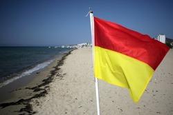 Summer beach swimming caution flag