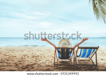 Summer beach travel vacation concept, Happy traveler asian woman with hat relax on chair beach at Pattaya, Chon Buri, Thailand Stock photo ©
