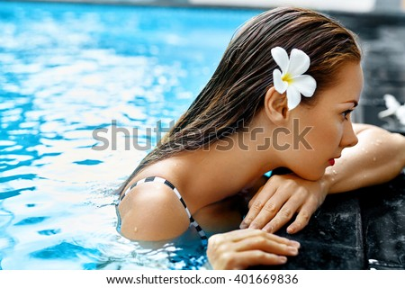 Summer. Beautiful Sexy Young Woman, Girl With Healthy Skin In Bikini Relaxing In Swimming Pool Water In Resort Relax Spa Hotel. Holidays Vacation. Body Health Care, Beauty Concept. Lifestyle, Wellness