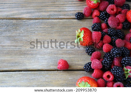 Summer berries on wooden background food closeup